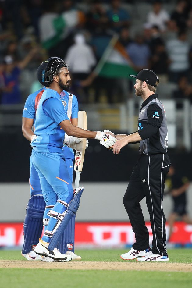 Kane Williamson of New Zealand (R) congratulates KL Rahul of India at the end of game two of the...