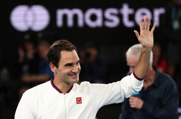 Switzerland's Roger Federer waves after defeating Hungary's Marton Fucsovics in their fourth round singles...