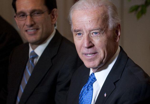 Then-Vice President Joe Biden, right, speaks alongside then-House Majority Leader Eric Cantor (R-Va.)...