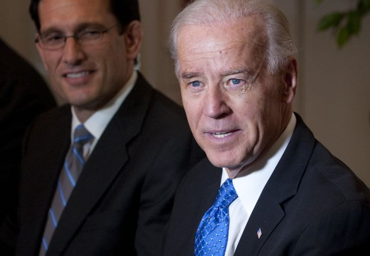 Then-Vice President Joe Biden, right, speaks alongside then-House Majority Leader Eric Cantor (R-Va.) during a debt reduction