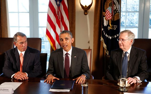 Then-President Barack Obama, center, persistently sought to find common fiscal ground with then-House...