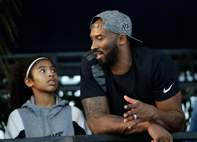 Former Los Angeles Laker Kobe Bryant and his daughter Gianna watch the U.S. national championships swimming...