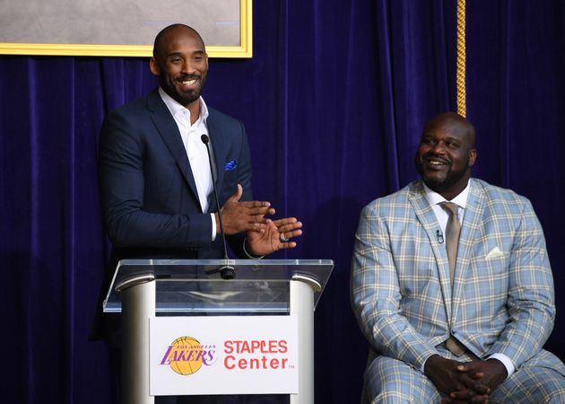 Bryant speaks during ceremony to unveil statue of Los Angeles Lakers former center Shaquille O'Neal at...