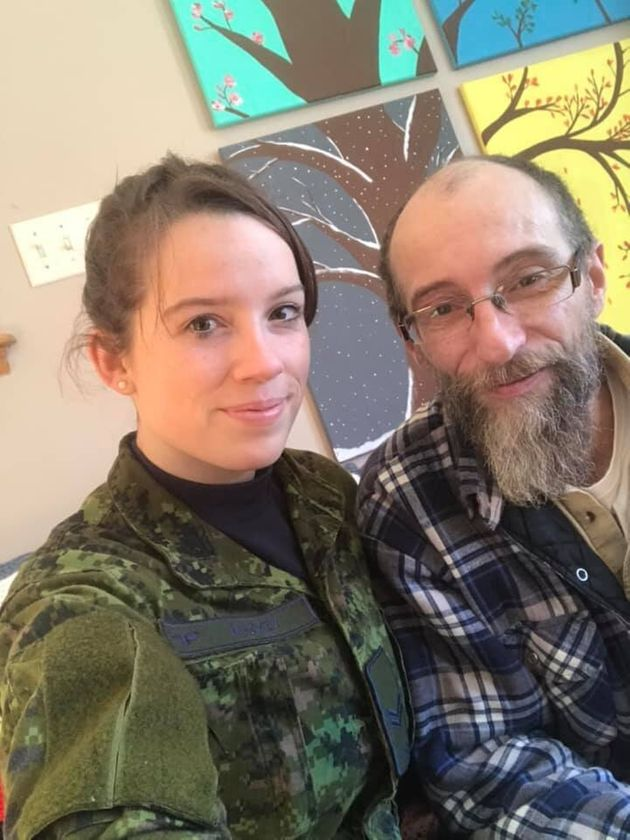 Tiffany Mackey poses with her father while helping out in