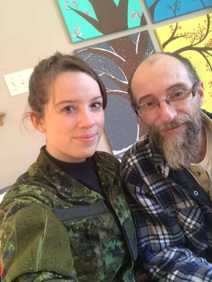 Tiffany Mackey poses with her father while helping out in Newfoundland.