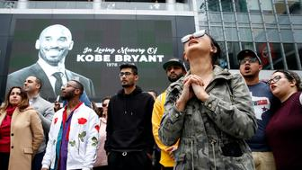 Mourners gather near an image of Kobe Bryant shown on a large screen outside the Staples Center after the retired Los Angeles Lakers basketball star was killed in a helicopter crash, in Los Angeles, California, U.S. January 26, 2020. REUTERS/Monica Almeida