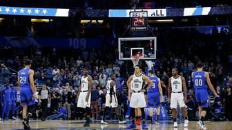 ORLANDO, FLORIDA - JANUARY 26:  The Orlando Magic take a 24-second shot clock violation to honor the memory of former NBA player Kobe Bryant who died in a helicopter crash during the first half against the LA Clippers at Amway Center on January 26, 2020 in Orlando, Florida. NOTE TO USER: User expressly acknowledges and agrees that, by downloading and/or using this photograph, user is consenting to the terms and conditions of the Getty Images License Agreement.  (Photo by Michael Reaves/Getty Images)
