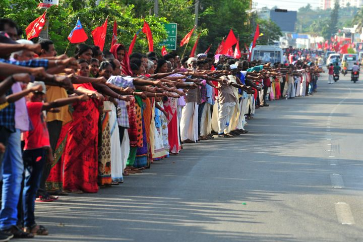 People line up along a road to form a 620 km human chain across Kerala organized by the Left Democratic Front (LDF) to protest against the Citizenship Amendment Act (CAA), Thiruvananthapuram on January 26, 2020.