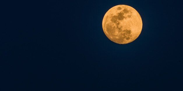 March full moon on a dark blue background as seen from Daejeon, South Korea using a Nikon D500 and a...