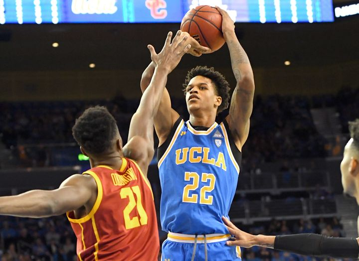 Onyeka Okongwu #21 of the USC Trojans defends a shot by Shareef O'Neal #22 of the UCLA Bruins in a game at Pauley Pavilion on