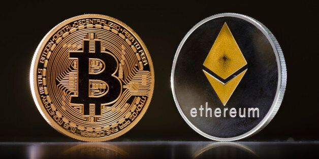 Berlin, Germany - January 09: Coins of the cryptocurrencies Ethereum and Bitcoin stands on a table on...