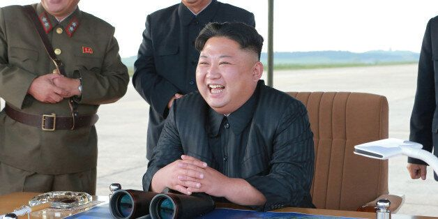 North Korean leader Kim Jong Un guides the launch of a Hwasong-12 missile in this undated photo released...