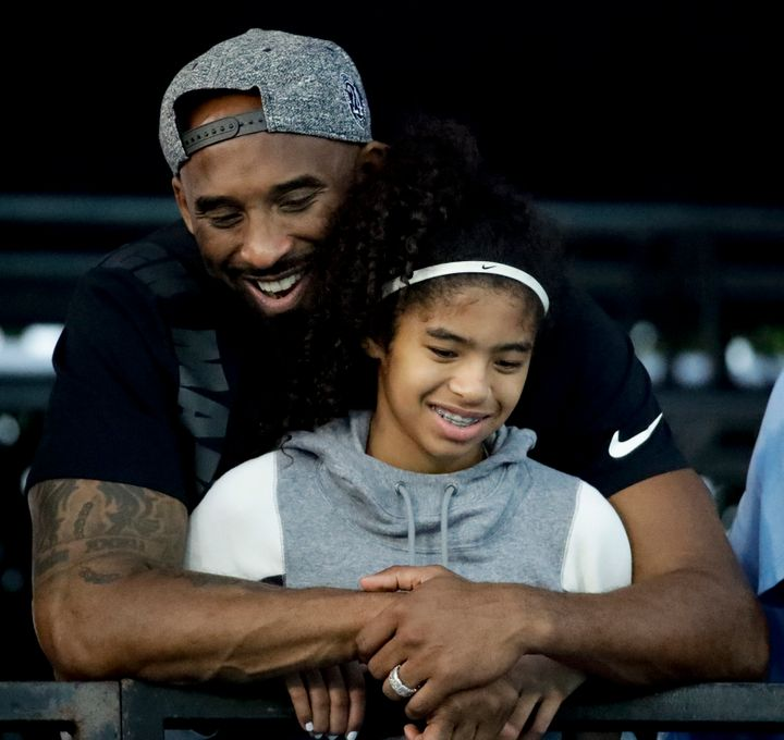 In this July 26, 2018 file photo former Los Angeles Laker Kobe Bryant and his daughter Gianna watch during the U.S. national