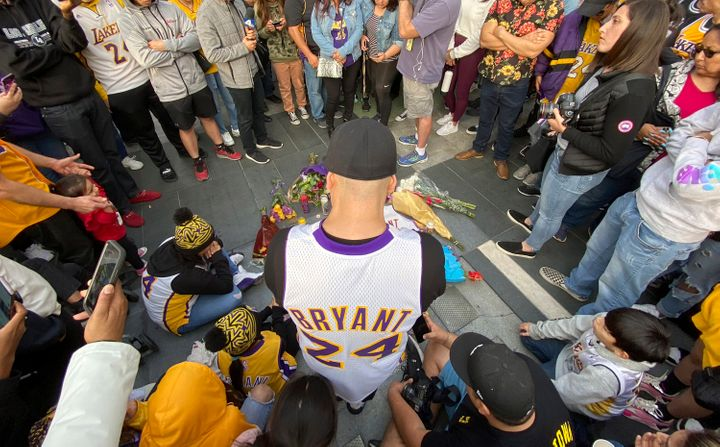 Fans mourn the loss of Kobe Bryant with makeshift memorials in front of La Live across from Staples Center, home of the Los A