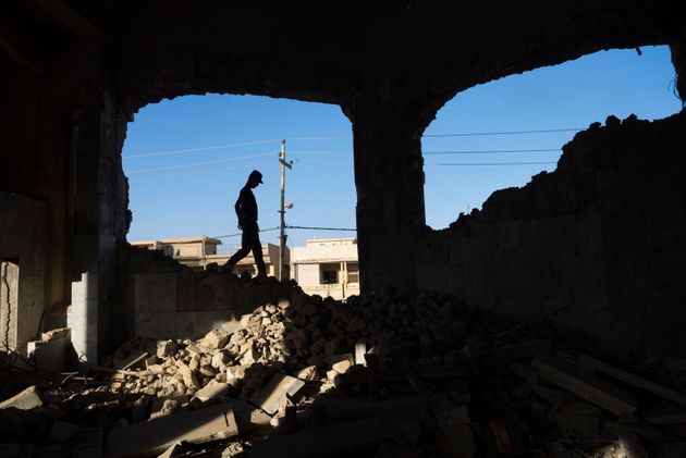 Mosul, Iraq - May 24, 2017: An Iraqi man walks in the rubble of the heavily damaged Church of St. Ephraim,...