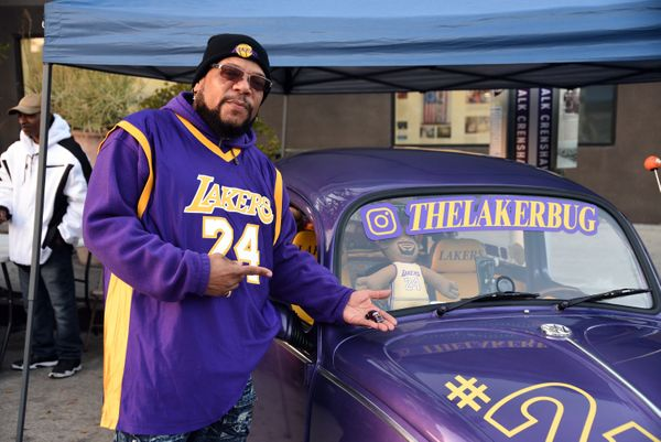 Darrin Dnote Milton with his car, the Laker Bug, at a vigil for Kobe Bryant in Los Angeles on Jan. 26.