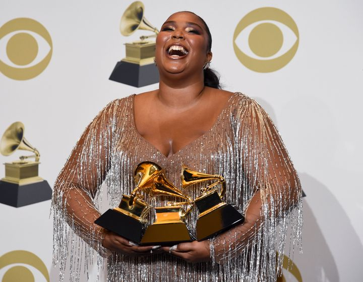 Lizzo poses poses with her Grammy awards on Sunday.