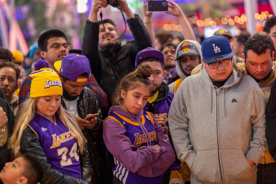 Fans seen paying homage to Kobe Bryant in Los Angeles on Jan. 26.