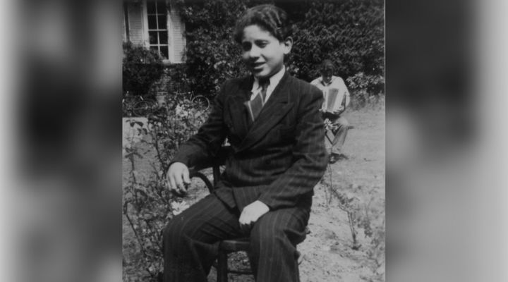 Pinchas Gutter at about age fourteen wearing a new suit in Ascot, England in 1946.