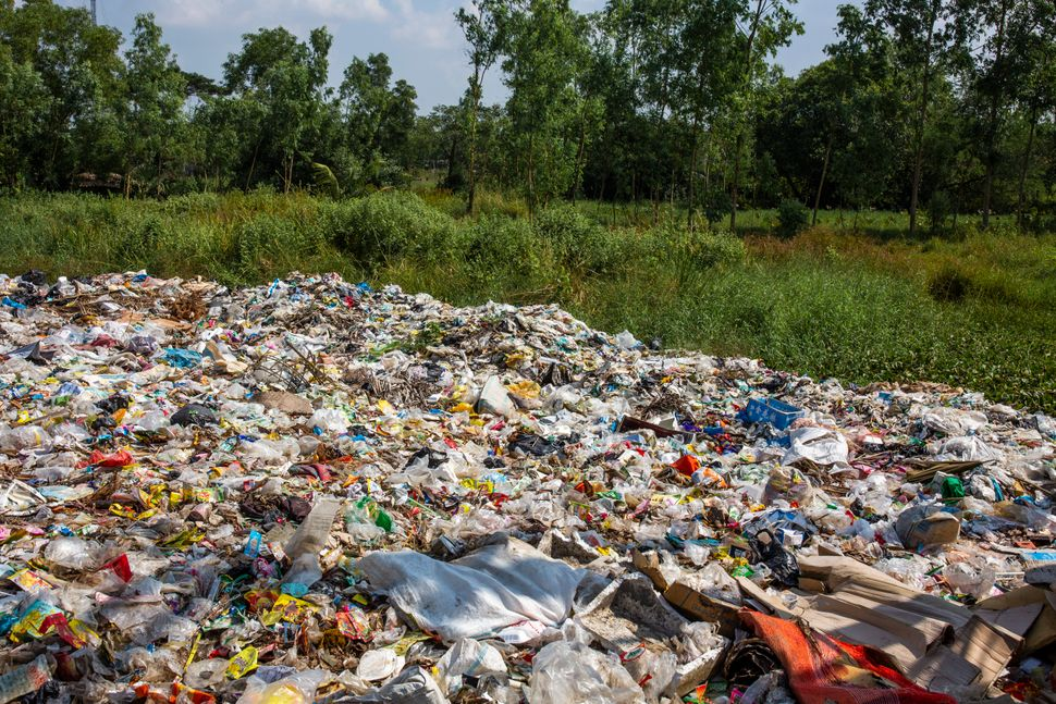 A dump site with plastics beside the road in Mingalun village, in Yangon division,