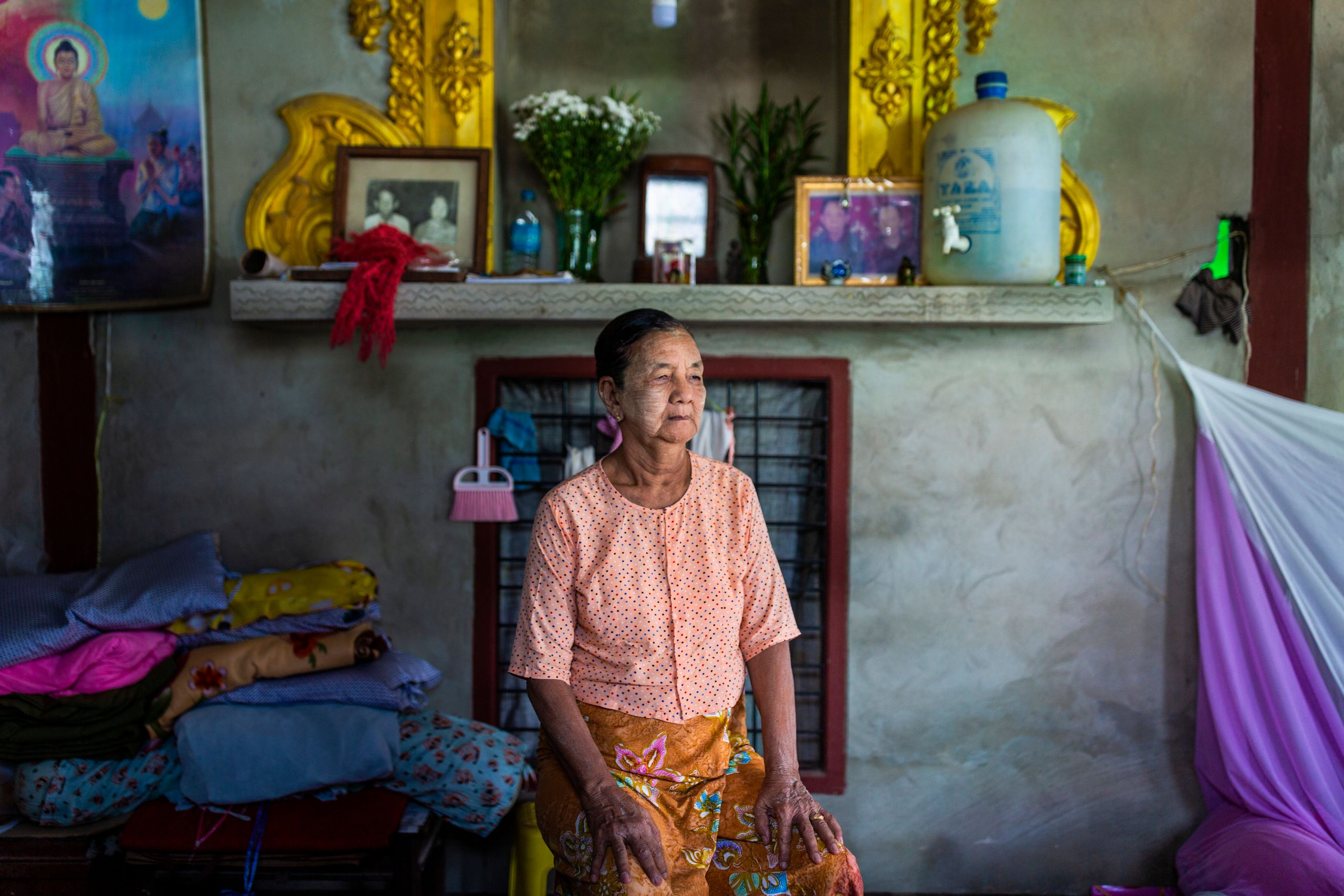 Daw San Aye, 72, poses for a portrait in Yangon division, Myanmar. She says life has improved since plastic has been introduc