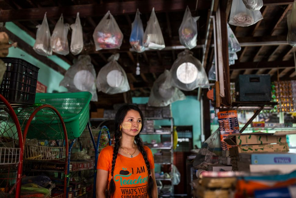 Lai Lai Swe, 32, poses in her shop in Mingalun village, in Yangon division,