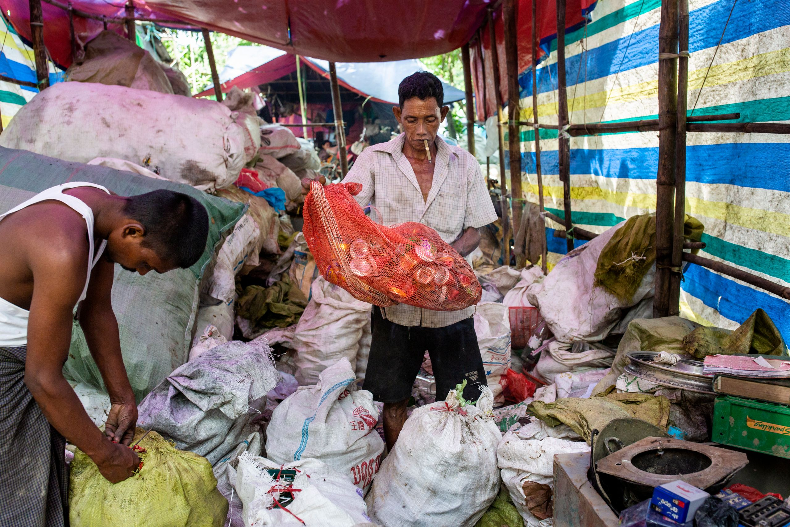 A man organizes materials at the recycle shop before sending them to the recycling factory.