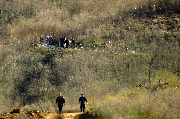 Les enquêteurs sur la zone de l'accident qui a coûté la vie de neuf personnes dont...