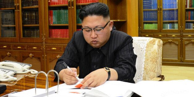 North Korean Leader Kim Jong Un signs the order to carry out the test-fire of inter-continental ballistic...