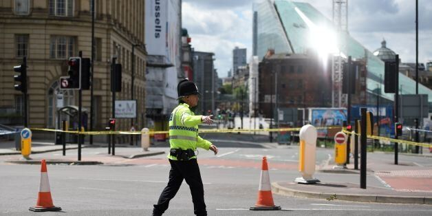 A police officer potrols a cordon near to the Manchester Arena in Manchester, northwest England on May...