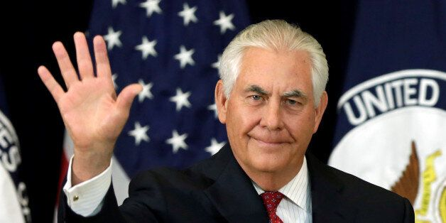U.S. Secretary of State Rex Tillerson waves after delivering remarks to the employees at the State Department...