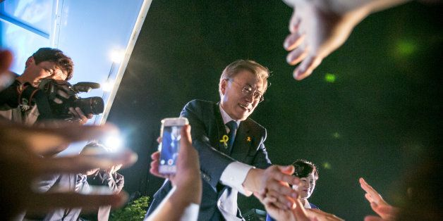 SEOUL, SOUTH KOREA - MAY 09: Mr. Moon Jae-in, the president-elect, greets supporters after his victory...