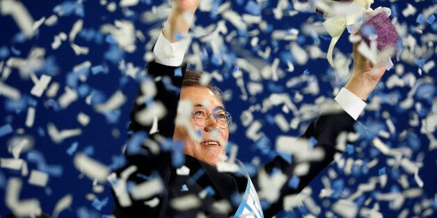 Moon Jae-in celebrates after winning the nomination as a presidential candidate of the Minjoo Party,...
