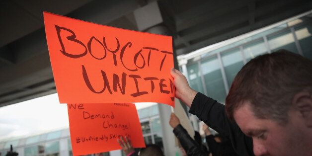 CHICAGO, IL - APRIL 11: Demonstrators protest outside the United Airlines terminal at O'Hare International...