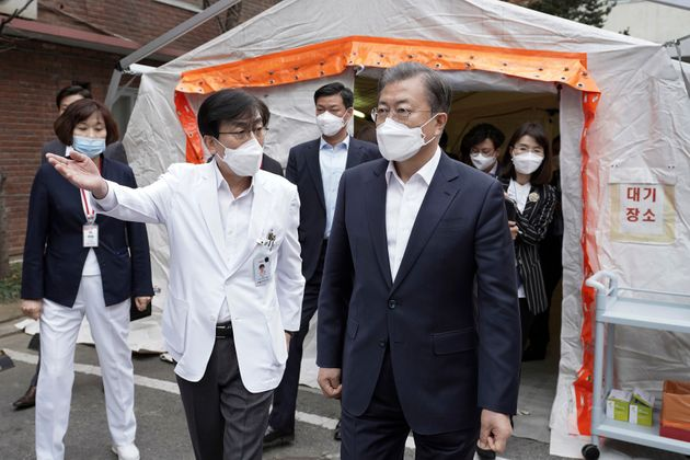 In this photo provided by South Korea Presidential Blue House via Yonhap News Agency, South Korean President...