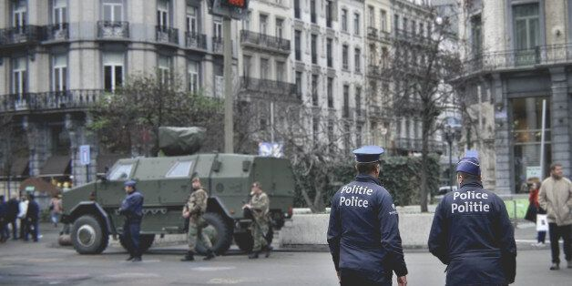 Brussels, Belgium - November 21, 2015: Police and army patrols the streets one week after Paris attacks...