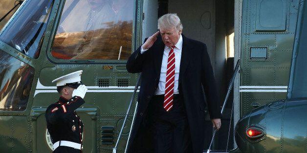 WASHINGTON, DC - FEBRUARY 06: U.S. President Donald Trump salutes a Marine while stepping off of Marine...