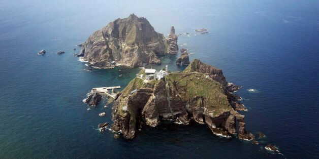 A set of remote islands called Dokdo in Korean and Takeshima in Japanese is seen in this picture taken...