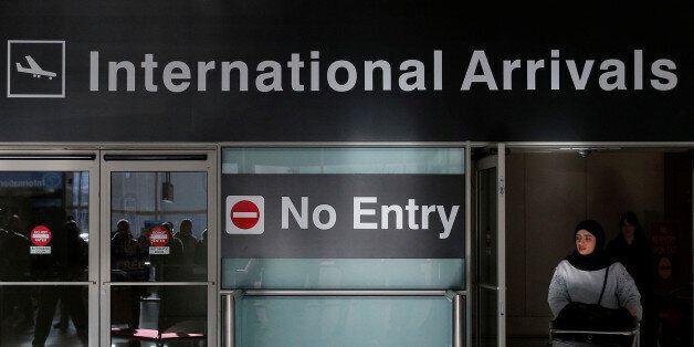 An international traveler arrives after U.S. President Donald Trump's executive order travel ban at Logan...