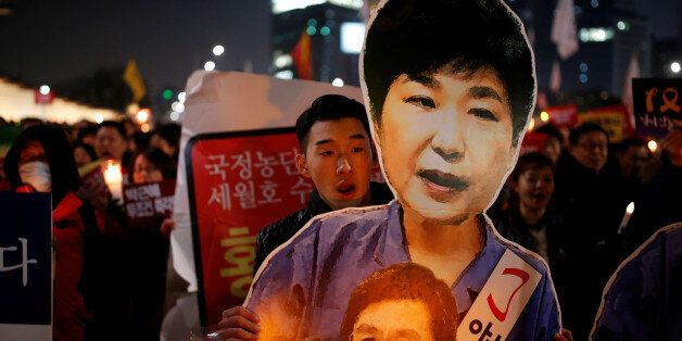People march toward the Presidential Blue House during a protest demanding South Korean President Park...