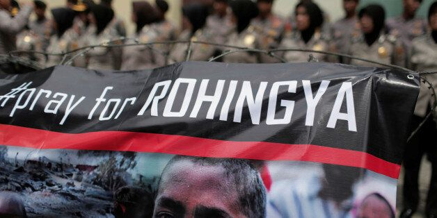 A banner is seen during a protest against what demonstrators say is the crackdown on ethnic Rohingya...