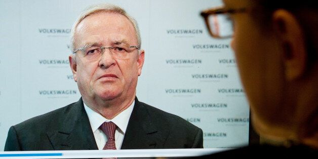 A woman watches a video statement by Volkswagen AG  CEO Martin Winterkorn, on the company's website,...