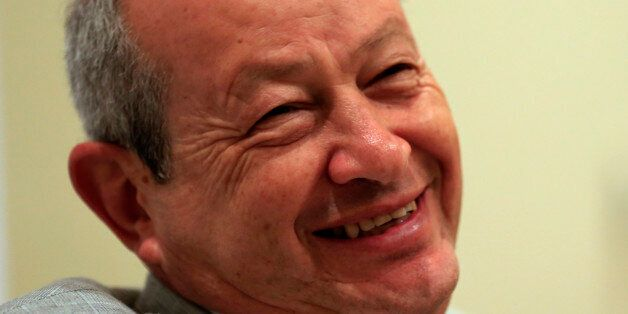 Egyptian billionaire businessman Naguib Sawiris speaks to The Associated Press prior to the opening of...