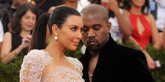 Kim Kardashian, left, and Kanye West arrive at The Metropolitan Museum of Art's Costume Institute benefit...