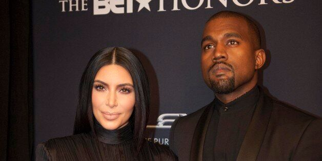 Kim Kardashian and Kanye West arrive on the red carpet at the BET Honors 2015 at Warner Theater on Saturday,...
