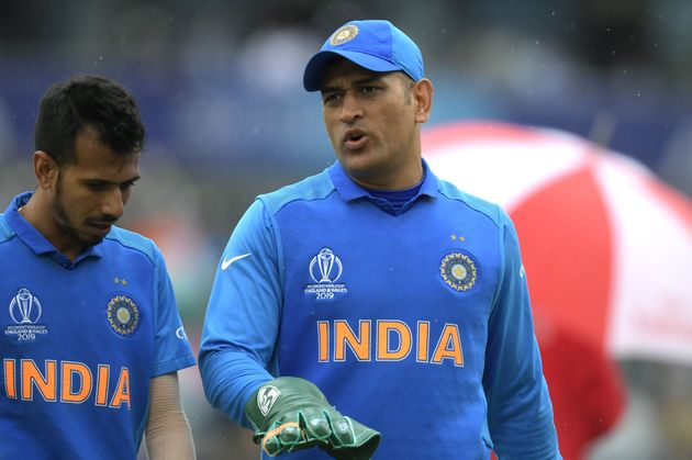 MS Dhoni and Yuzvendra Chahal as they walk off the field during the 2019 Cricket World Cup semi-final...