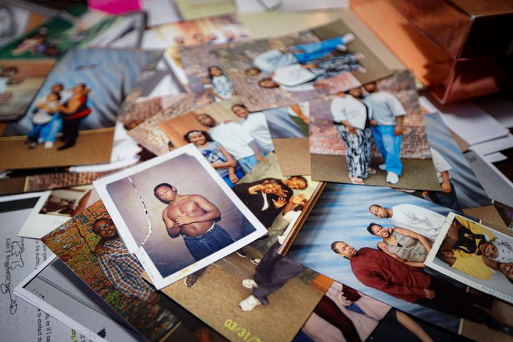 Family photos of Myon Burrell during his teenage years before and after incarceration are displayed a the home of his sister,