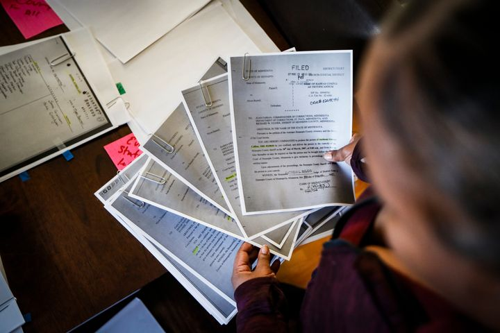Ianna Burrell pours over documents and photographs of her incarcerated brother Myon Burrell at her home, Friday, Oct. 25, 201