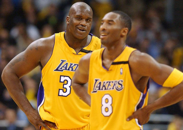 O'Neal laughs with Bryant a Lakers win against the Chicago Bulls in Los Angeles on Nov. 22, 2002.