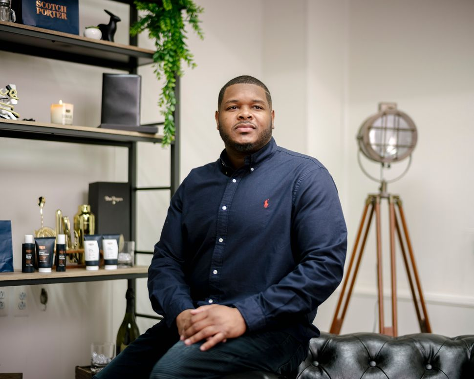 Calvin Quallis, founder of Scotch Porter, poses for a portrait at his warehouse and office space. Scotch Porter is a men's grooming business with a line of products for hair, beards, shaving and skin.